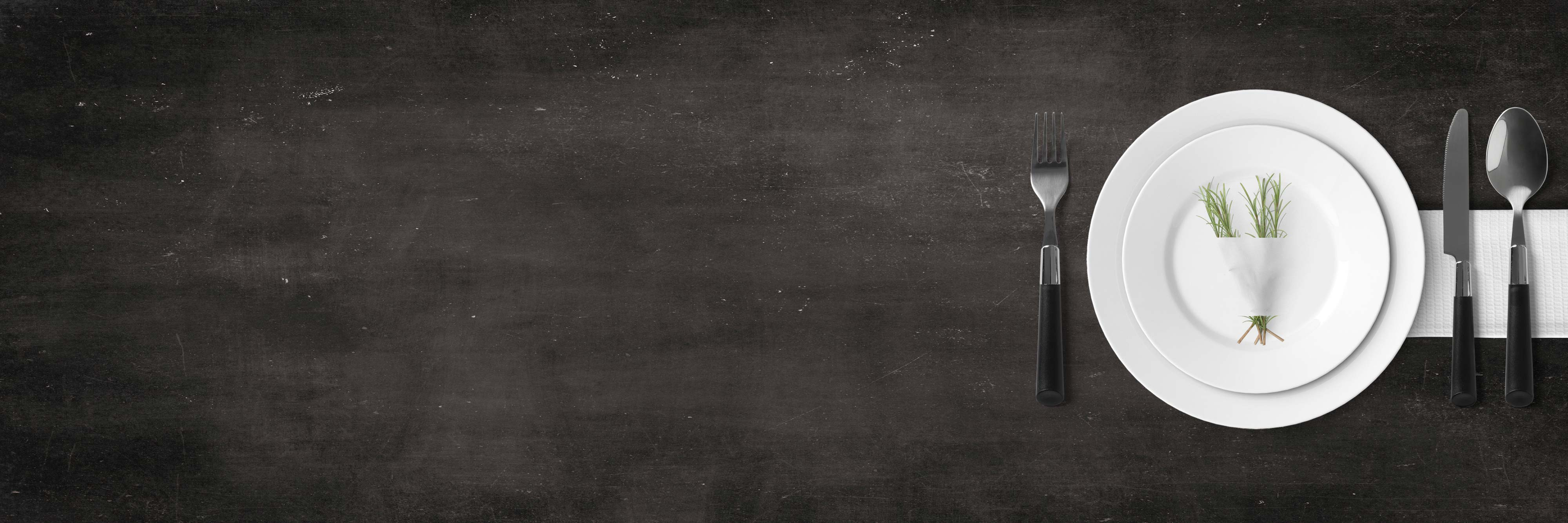 black chalkboard background with a set dinner plate