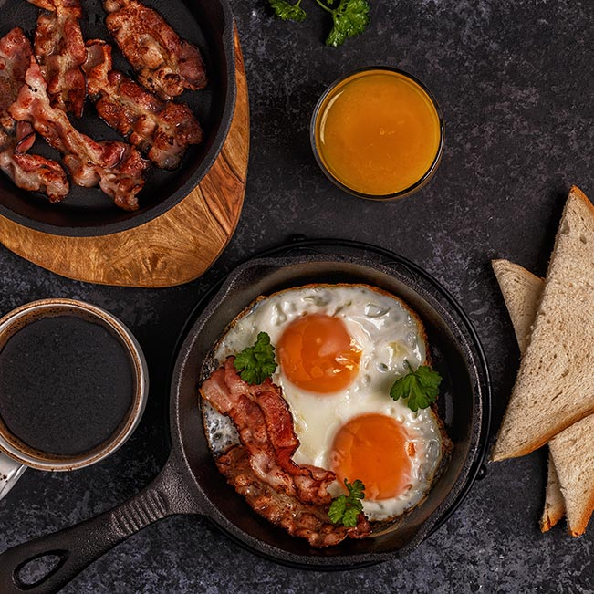 Egg skillet with bacon, orange juice and toast
